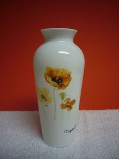 "Beautiful decorative collectible Marjolein Bastin white glass vase with orange Poppies floral design.  6"" tall and 2 1/2"" in diameter at its widest point.  Mint condition, this vase will add beauty to any setting!"