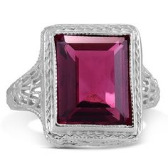 Fine milgrain and pierced geometric frames embellish the shank and gallery of this Edwardian ring, presenting a ravishing pink tourmaline at the center (Tourmaline approx. 3.50 total carat weight).