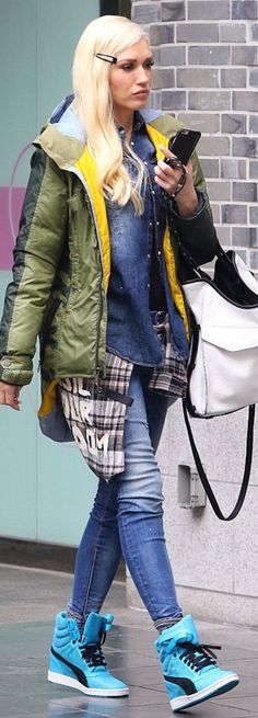 Who made Gwen Stefani's blue sneakers, skinny jeans, green coat, and white pocket?