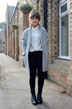 Long jacket over  white button-down and black skirt