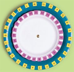 I like the idea of using two sizes of paper plates with a brad.  So many uses. Matching uppercase to lowercase letters, matching beginning sound to picture, matching ending sound to picture, matching two different fonts for the same letter, and on and on.