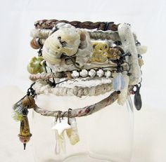 Drop of the Ocean. Rustic Victorian tribal bangle set with found beach stones, pale white cream assemblage.