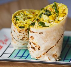 Vegan Breakfast Burrito Recipe Breakfast and Brunch with vegan butter, bell pepper, diced mushrooms, firm tofu, garlic powder, cayenne, black pepper, tumeric, truffle salt, olive oil, agave nectar, liquid smoke, apple cider vinegar, spinach, Daiya, tortilla wraps