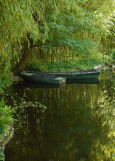 Boats in the Pond in Monet's Garden in Giverny, France.