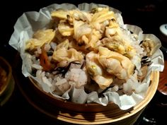 Asari clams with healthy brown rice steamed in bamboo container.