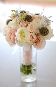 cream peonies, pale pink roses, scabiosa pods, stock and grey kochia filler - gorg!