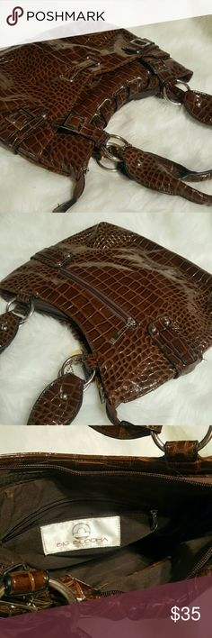 Big Buddha handbag Double handle. Two front pockets. Compartments on inside. Classic faux Croc handbag. Excellent condition. Brown. Measurements to come Big Buddha Bags