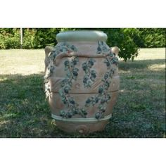 Terracotta jar decorated with hand painted olives. Every terracotta object can be decorated with patterns and decorations, both from classic and moder tradition, entirely handmade.