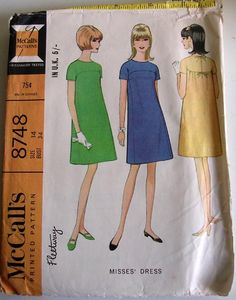 McCall's 8748; ©1967; Misses' Dress. Five panel dress has short sleeves cut in one with front and back yokes. Dress back is gathered to yoke at back and yoke opening is hooked under applied bias bows of self fabric. Neck is faced and interfaced and dress may be underlined.
