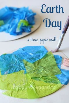 Earth Day Crafts by happy hooligans using cardboard, blue & green tissue paper, and glue to create the Earth.