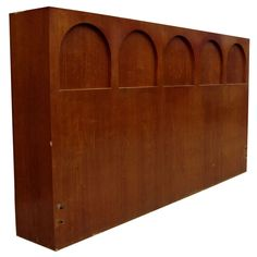 Vintage Widdicomb Arcade Headboard  USA  1960's  a walnut storage headboard with arcade detail concealing storage across the top, and a drop-down table in the center.