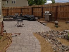 Paver patio with designated BBQ deck