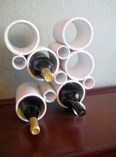 If you enjoy modern decor, embrace PVC pipe's industrial look by crafting an abstract wine holder that's sure to be a conversation piece. Click through for the tutorial and more DIY PVC pipe organizers. Pvc Pipe Storage, Wine Storage, Storage Ideas, Yarn Storage, Storage Hacks, Storage Solutions, Pvc Pipe Projects, Wine Bottle Holders, Bottle Rack