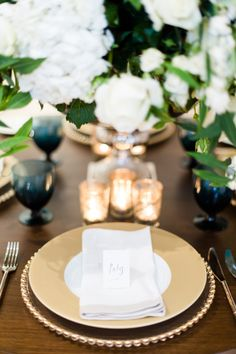 """""""I love a touch of gold – over the last couple of years I've seen my couples allow it back onto their table settings.  I think done in the right quantities gold can look perfectly in place…  The uber chic place cards are by my dear friend Fin Fellowes.""""  - Mark Niemierko"""
