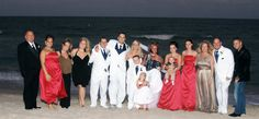 Formal family portrait on the beach.