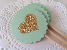 Mint and gold glitter cupcake toppers. These elegant cupcake toppers or food picks are a perfect way to add charm to your wedding, bridal or baby shower or just about any special event! Chic and glamorous!