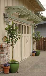 Trellis above garage doors create a   wonderful look, beautiful with climbing roses