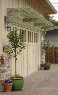 Double garage door arbor bracket and trellis installation, California.