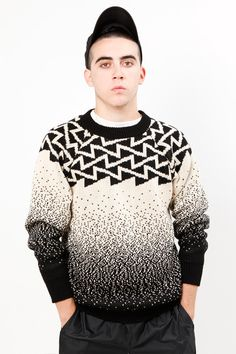 Photo of a #knitted sweater done one by one using knitting machine  - cool black and white combinations