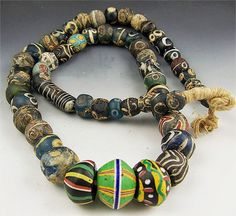 Fabulously beautiful strand of ancient beads from Djenne, Mali and other parts of the ancient Islamic world. The three center King Beads are quite nice, as are the other millifiori beads sprinkled throughout the necklace.