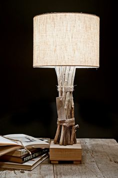Driftwood lamp- love this and would be easy to make.  With a nice course textured shade in burlap or buy a plain shade & cover with course linen, course textured wallpaper(grass paper) and tie with jute or rope as in the picture. (Doesn't really need the Block Base)( Goodwill Lamp to start with?)