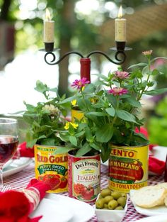Wildflowers in tomato cans perfect for an Italian themed rehearsal dinner.
