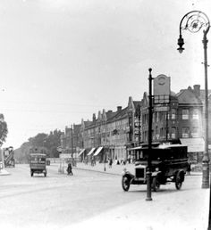 Stamford Hill - the vehicle in right foreground is one of the old fashioned London taxis of the time. 1920s/30s