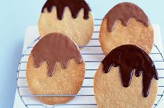 Egg-shaped cookies with melted chocolate #easter