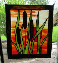 Stained glass suncatcher original design by RockinMosaics cattail in the sun