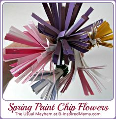 A colorful flower craft using paint chips! Perfect for the kids to make for Spring or as a gift for mom or grandma for Mothers Day. From The Usual Mayhem at B-InspiredMama.com