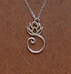 In many cultures, the lotus symbolizes purity and new beginnings. Since the lotus flower has buds, blossoms, and seed pods simultaneously on the same plant, it has come to represent the past, present, and future.     $32