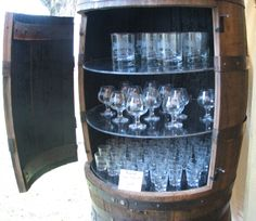 Whiskey barrel used for bar storage. This site has tons of barrel decor ideas!