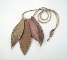Leather feathers- I could cut these out of gold and attach to the headdress