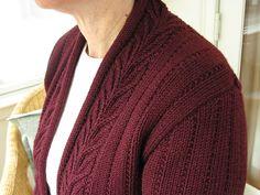FREE pattern ~ An elegant cardigan worked flat in one piece to the underarms. Collar band is knit with the fronts and only requires seaming at the back of the neck. Center front edge is rolled for a corded effect. Free Knitting Patterns For Women, Knit Patterns, Knitting Ideas, Knit Cardigan Pattern, Cable Knit Cardigan, Long Jackets, Knit Or Crochet, Free Pattern, One Piece
