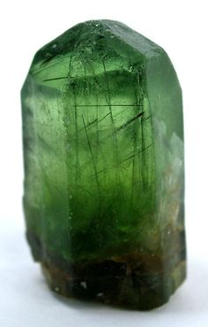 Forsterite (Var: Peridot), Ludwigite | ©Fine Mineral Galleries | iRocks.com Sapat Gali, Manshera, Naran-Kagan Valley, Kohistan District, North-West Frontier Province, Pakistan. This crystal has unusually good, intense lime-green color and internal clarity. You can see inside the needle-like crystals of Ludwigite, for which this locality is known.
