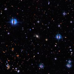 """Find A """"Space Warp"""" Astronomers Seek Online Volunteers In Search For Space Warps  Cosmic needle in a haystack: spotting a space warp (gravitational lens) in an image of thousands of other galaxies is tricky"""