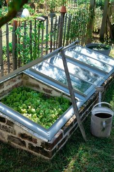 Mini greenhouse made from recycled bricks & windows.