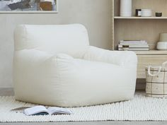 This squeezable foam-filled floor chair is good in tight spaces. And, because it's designed without a wooden frame, it's brilliant for bouncing. Unique Furniture, Vintage Furniture, Furniture Ideas, Thatched House, Floor Chair, Wooden Frames, Things That Bounce, Living Room Decor, Kids Room