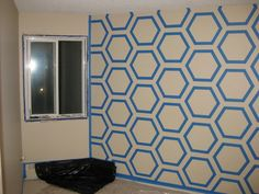 painter's tape wall art- I would do with gold washi tape on my cream walls for a subtle shimmer