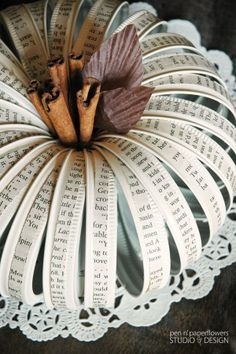 this is pretty stinking cute...i can't imagine EVER making pumpkin decor, but the vintage paper just calls my name...