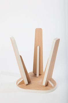 Tenon Stool is a minimalist design created by California-based designer Okum Studios. Utilizing the accessibility of sheet stock and local automated manufacturing, Tenon Stool is constructed of 7 precision-machined parts. The pieces slot together through mortise and tenon joints, resulting in a highly efficient design. Edges band in high-pressure laminate graphically frame the warmth of wood. A lateral spine reminiscent of bridge-support works in connecting leg to seat. (3)
