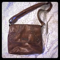 Nine West leather purse Nine West leather purse. Silver studs on bag gently used Nine West Bags Satchels