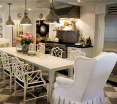 Love the wing back chairs at the dining table!