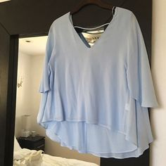 """Zara Periwinkle Shirt NWT never worn Zara beautiful periwinkle blue """"butterfly"""" blouse. Really unique, low back with strap across. V front- very flatter and Beautiful on! Size Medium. Zara Tops Blouses"""