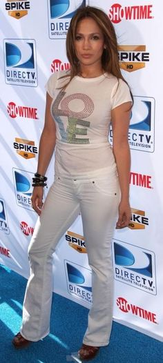 Who made Jennifer Lopez's white jeans and brown shoes that she wore to DirecTv's 4th annual celebrity beach bowl in Miami, February 06, 2010?