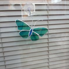 Blue Streaky Butterfly  Stained Glass Sun catcher / Window Decor by SunraysStainedGlass on Etsy