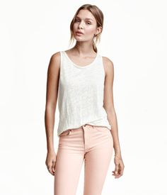 Gray melange. Tank top in linen jersey. Slightly lower-cut neckline at back and gently rounded hem with overlocked edges.