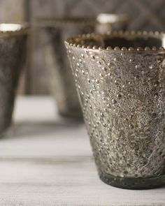 Our pewter mercury glass vases are textured with a criss cross beaded pattern, offering dancing light to your table top.