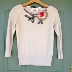 "Anthropologie Sweater ""RARE""! Darling sweater by Karen Nicol for Anthropologie. Rare and hard to find! Sweet rosette and and floral details! Slight shimmer to sweater. Very unique! Worn once or twice. True to fit size small. In excellent condition!! No trades/PayPal. Thanks! Anthropologie Sweaters Crew & Scoop Necks"