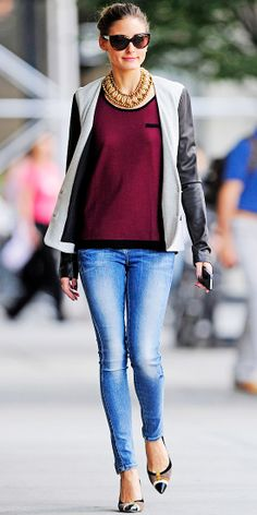 Always looking amazing! Olivia Palermo hit the street in a scoopneck sweater that she teamed with a leather topper, statement necklace, skinny jeans and cap-toe pumps.